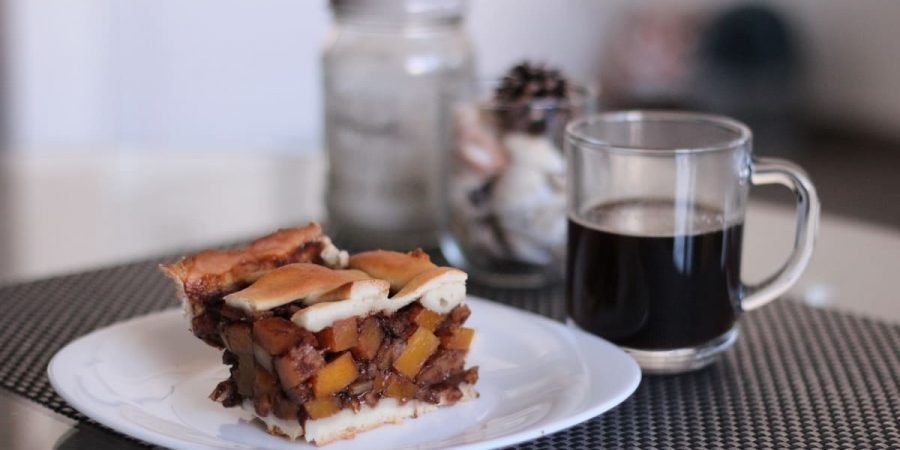 Easy Apple-Pumpkin Pie, served in a white dish with coffee