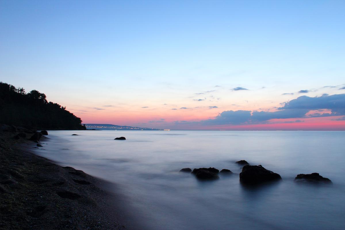 Seaside at sunset, long-exposure photo